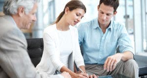 Young couple signing forms © iStock