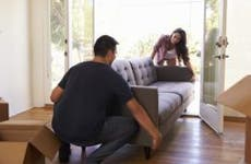 Couple moving couch into new house | Monkey Business Images/Shutterstock.com