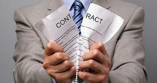 Man in suit ripping contract in half © Brian A Jackson/Shutterstock.com