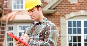 Contractor outside, writing on clipboard © Sean Locke Photography/Shutterstock.com