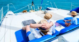 Back view of mother and children relaxing on a boat © BlueOrange Studio/Shutterstock.com