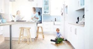 Family in white kitchen | Caiaimage/Trevor Adeline/Getty Images