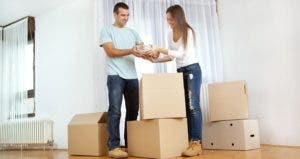 Couple unpacking boxes in new home © iStock