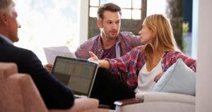 Couple talking to adviser © iStock
