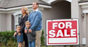Family standing outside their house for sale © iStock