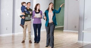 Realtor showing family an empty house