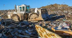 Bulldozer at landfill | Hero Images/Getty Images