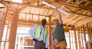 Architect and foreman discussing construction project | Bounce/Getty Images