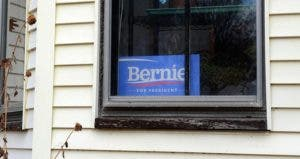 'Bernie Sanders for President' sign in house window | Darren McCollester/Getty Images