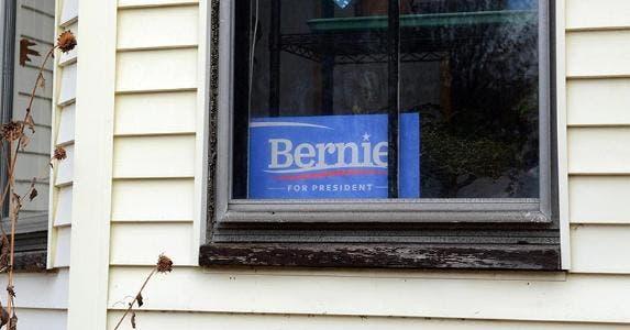 'Bernie Sanders for President' sign in window | John Lamparski/Getty Images