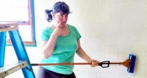 Woman scrubbing walls | Photo courtesy of Shawn Steen