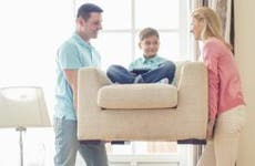 Couple moving young son sitting on chair © bikeriderlondon/Shutterstock.com