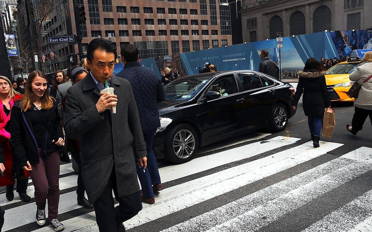 Pedestrians in Manhattan crossing street