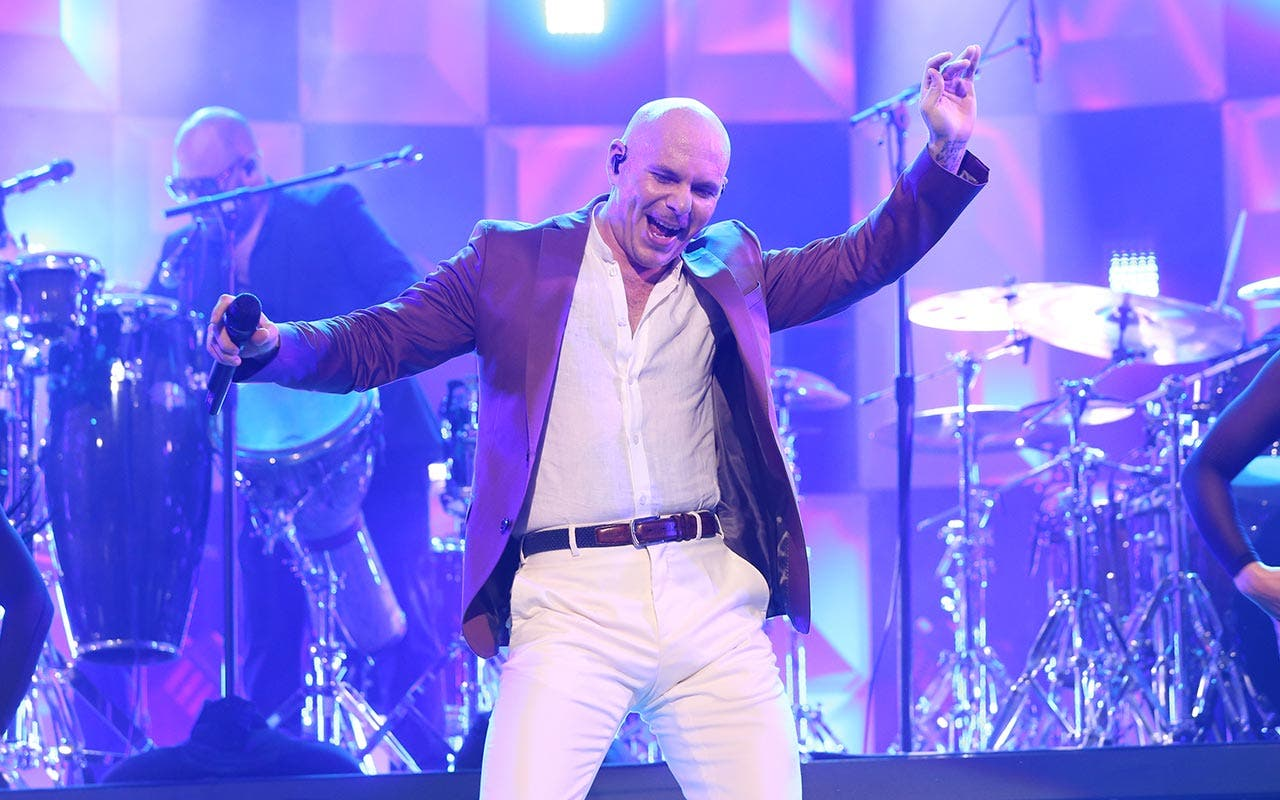 Pitbull performing on stage