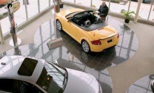 Man at Audi dealership car showroom