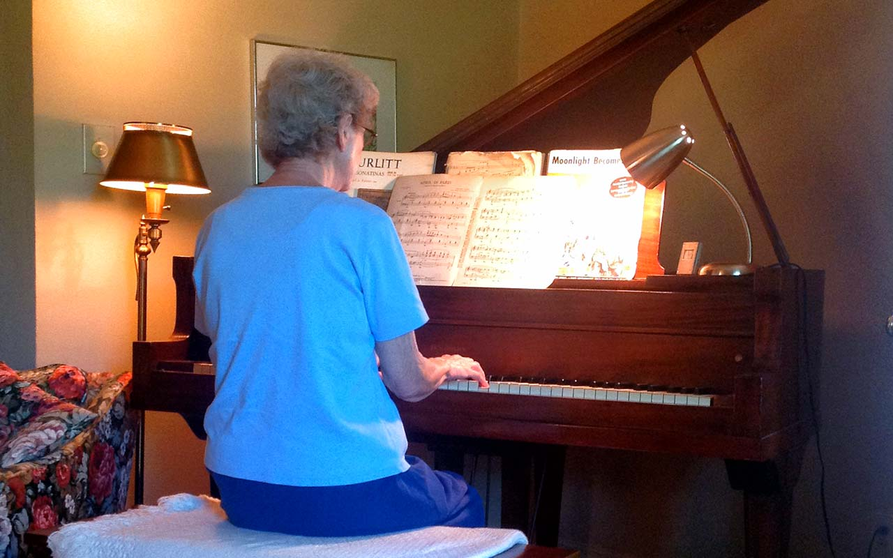 Holden's mother playing the piano