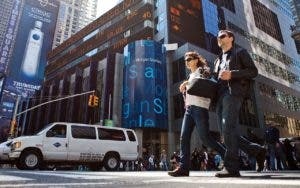 couple walking by morgan stanley building in Times Square