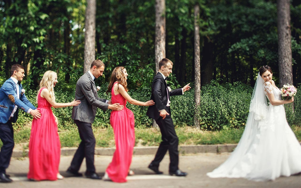 Bride leading a wedding conga line