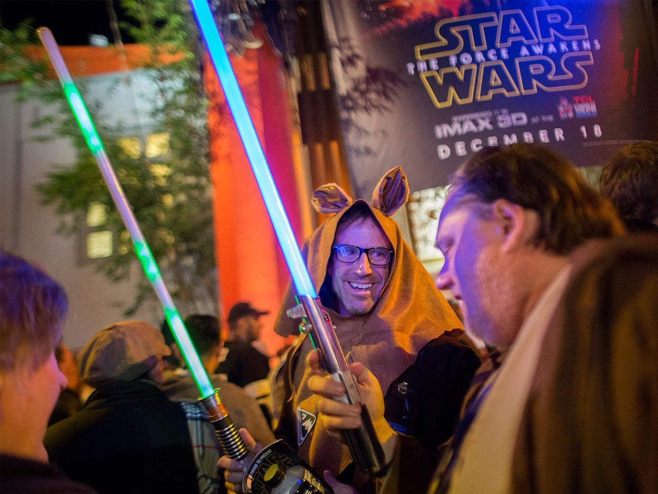 'Star Wars' fans standing outside movie theater in costume