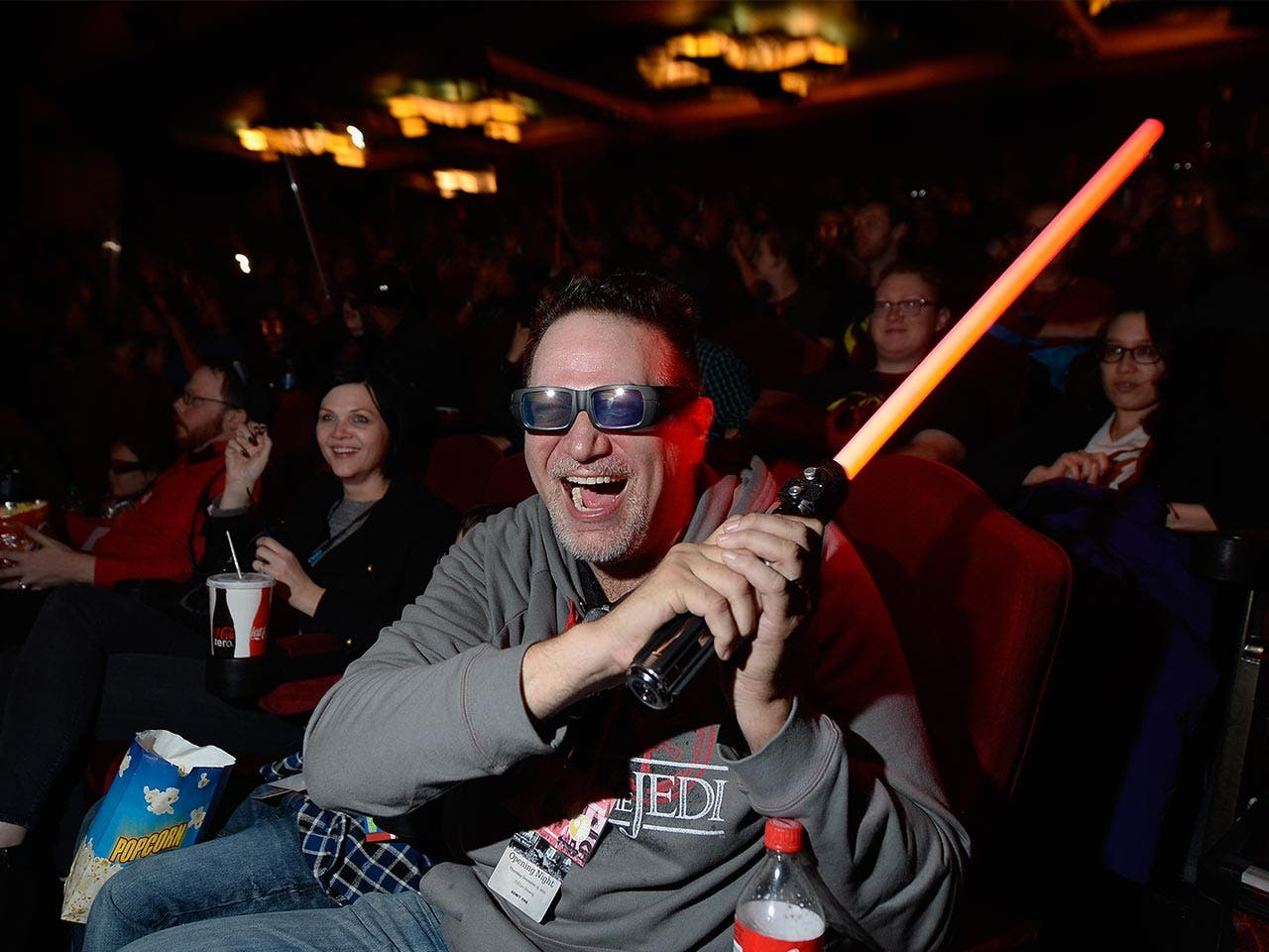 "Fan holding lightsaber at the ""Star Wars: The Force Awakens"" premiere"