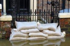 Flooded home entrance blocked by sandbags © ronfromyork/Shutterstock.com