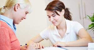 Woman filling out insurance paperwork © Robert Kneschke/Shutterstock.com
