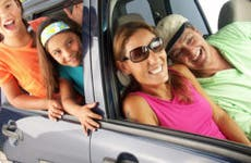 Happy family in the car on vacation © gosphotodesign/Shutterstock.com