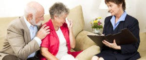 Upset elderly husband and wife meeting with an agent © Lisa F. Young/Shutterstock.com