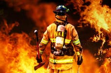 Firefighter walking into fire © storm - Fotolia.com