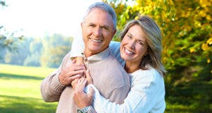 Retired couple outside embrace © Kurhan / Shutterstock.com