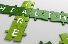 """The word """"health care"""" on a puzzle  © NUMAX3D/Shutterstock.com"""