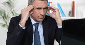 Man worried, looking at computer  © auremar/Shutterstock.com
