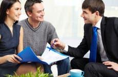 Couple listening to adviser explanation © Pressmaster/Shutterstock.com