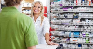 Pharmacist helping customer at counter  © Tyler Olson/Shutterstock.com