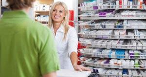 Pharmacist helping customer at counter  © Tyler Olson/Shutterstock.com