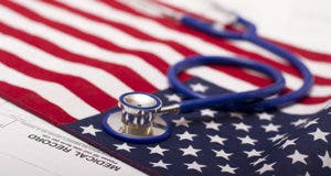 Stethoscope on United States flag  © Yaroslav Pavlov - Fotolia.com