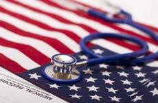 Stethoscope on United States flag  © Yaroslav Pavlov - Fotolia.com