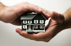 Man holding small house