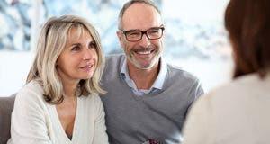 Senior couple meeting financial adviser for investment © Goodluz/Shutterstock.com