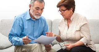 Senior couple going over savings © Alexander Raths/Shutterstock.com