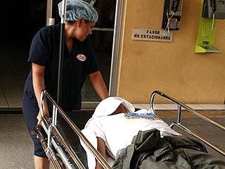 Man on stretcher, El Salvador © Luis Romero/Associated Press