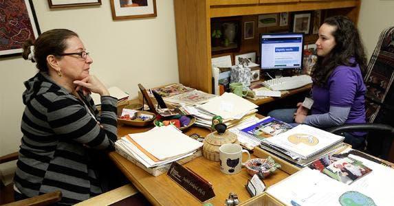 Woman sitting in health practitioner's office © Lynne Sladky/Associated Press