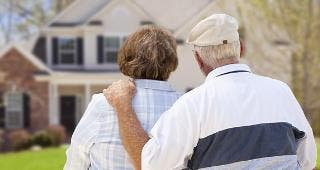 Senior couple looking at house © Andy Dean Photography/Shutterstock.com