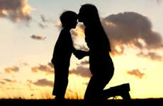 Mother kissing son's forehead © Christin Gasner/Shutterstock.com