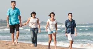 Family walking on beach © Sean van Tonder/Shutterstock.com