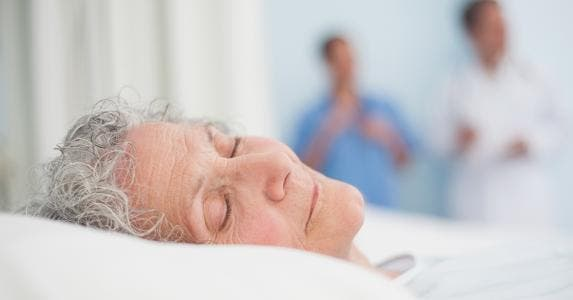 Elderly woman laying in hospital bed © wavebreakmedia/Shutterstock.com
