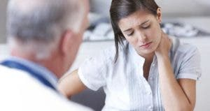 Doctor with upset young woman © iStock