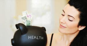 Woman holding piggy bank labeled 'health'