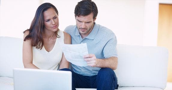 Couple reviewing paper together