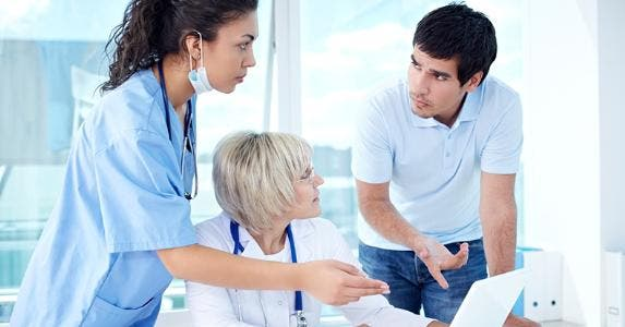Annoyed patient discussing with medical office staff © iStock